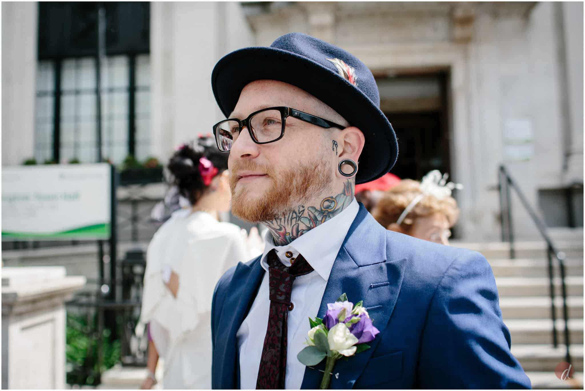 tattood groom at wedding