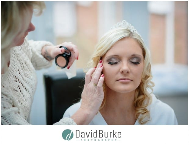 bride having makeup applied