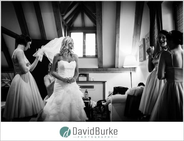 bride in bridal suite at cooling castle barn