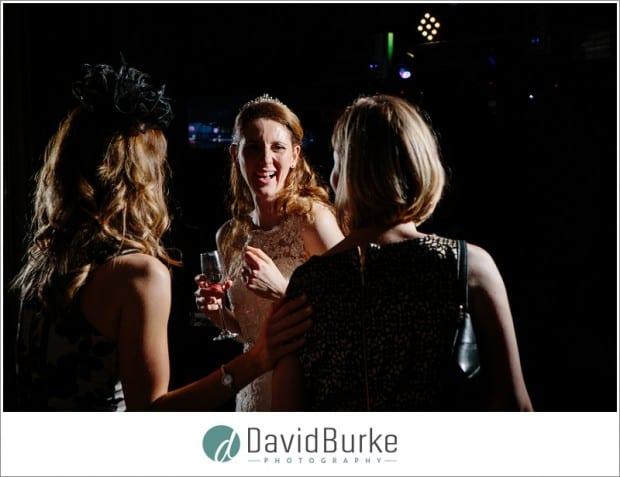 bride laughing on dancefloor