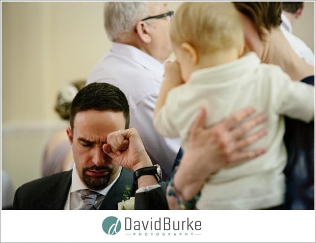 kid crying with guest at wedding