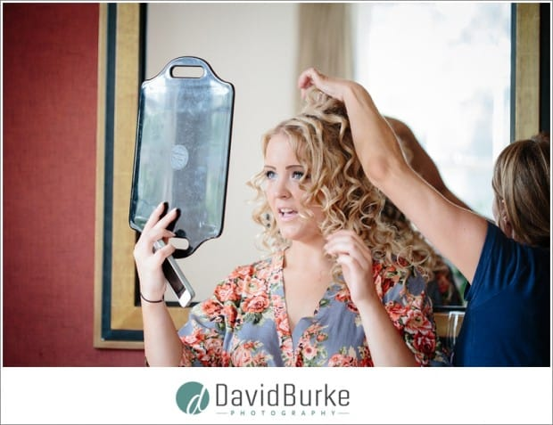 bridesmaid admiring hair in mirror