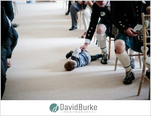 kid on floor in ceremony