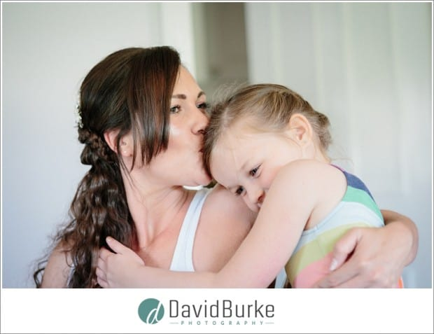 bride kissing daughter
