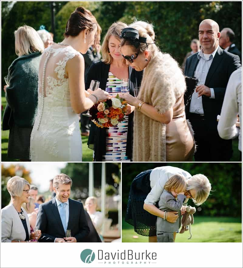 guests admiring bridal bouquet