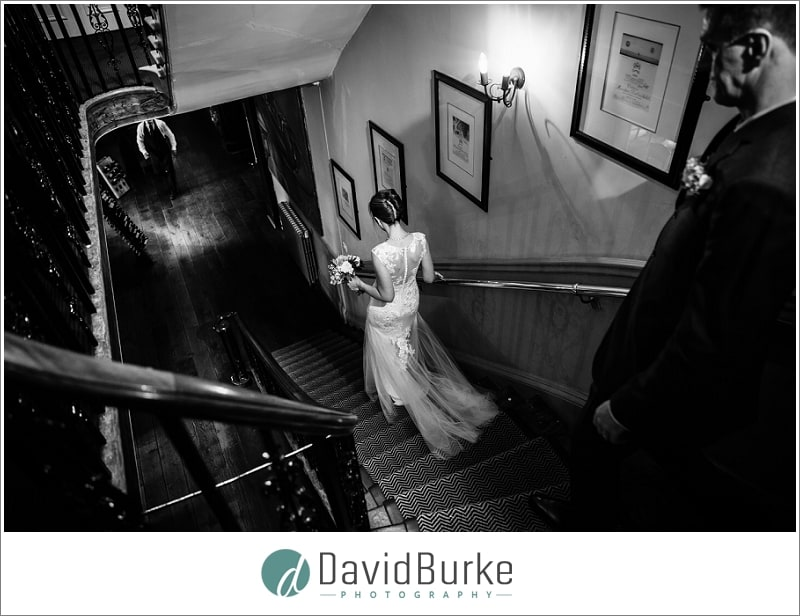 bride and groom on stairs hotel du vin tunbridge wells