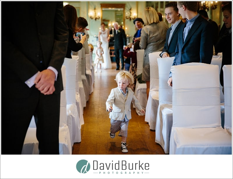 pageboy running down aisle