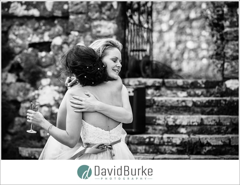bride and sister hug