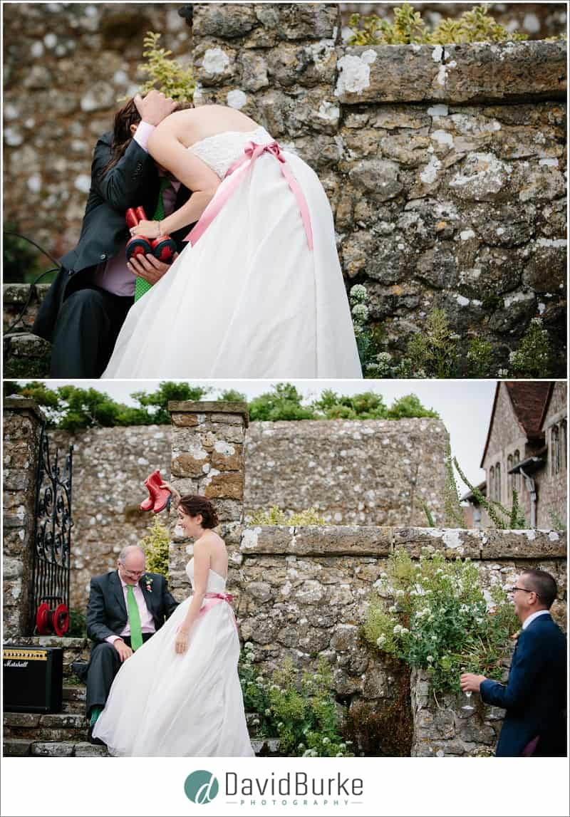 dad gives bride little red wellies