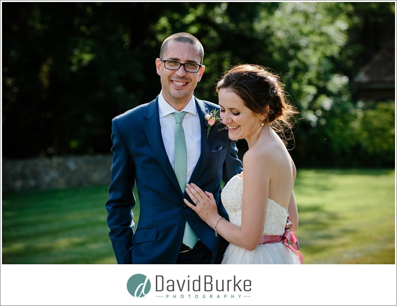 laughing bride and groom at lympne castle