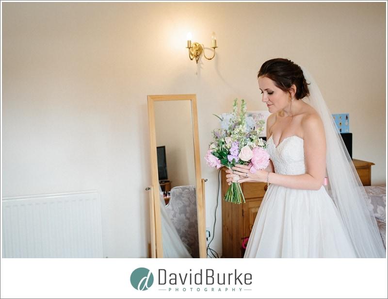 bride admiring bouquet