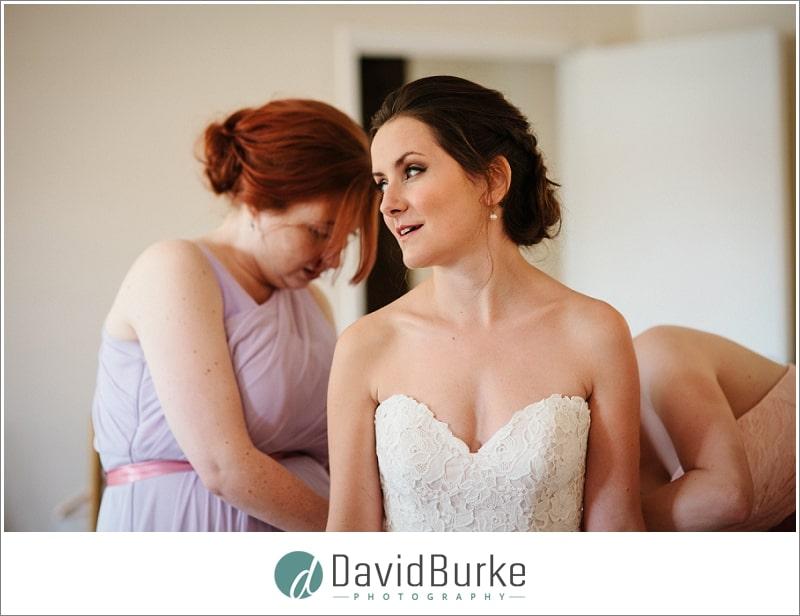 brides dress going on