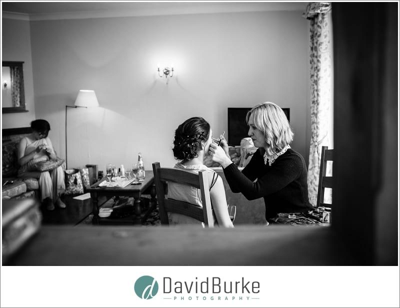 bride having makeup applied