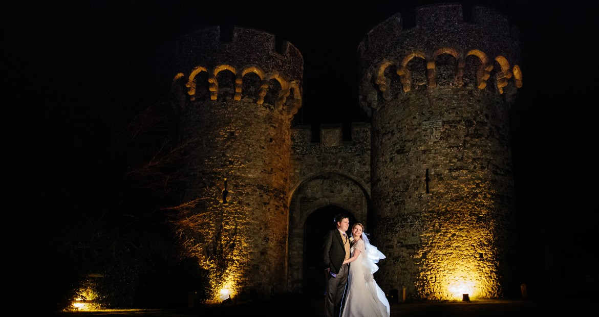 Cooling castle at night with bride and groom