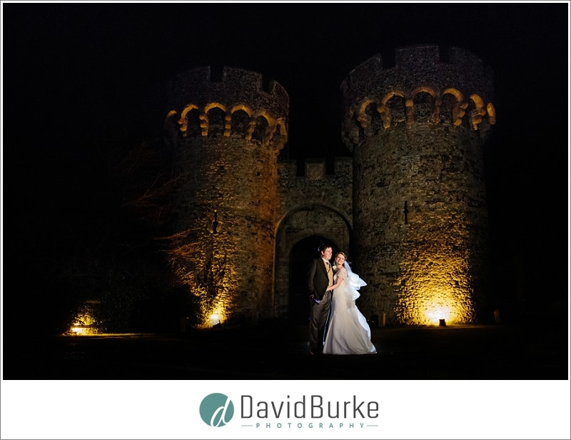 bride and groom cooling castle at night