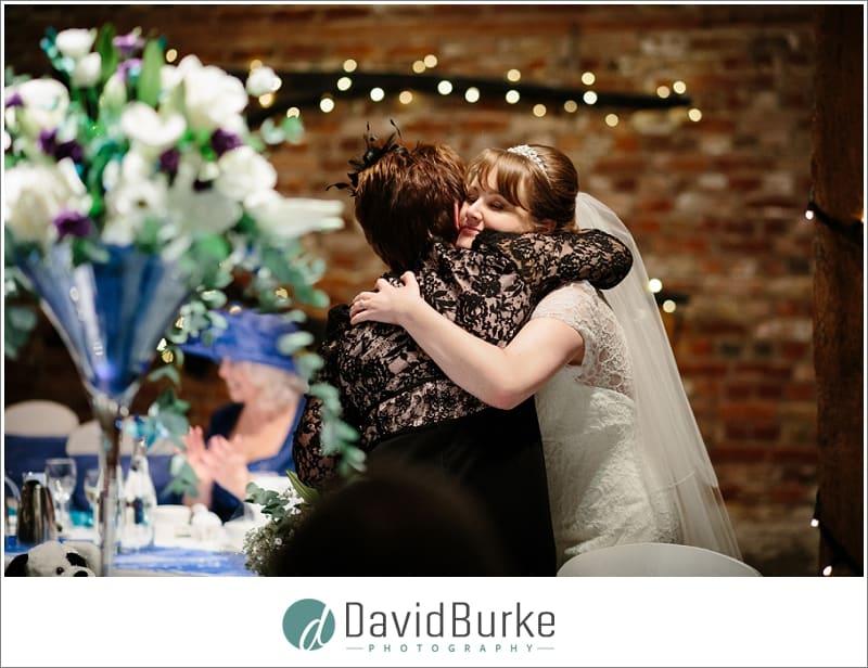 bride hugs cake maker