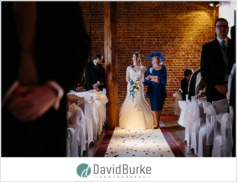 bride walking down the aisle at cooling castle barns