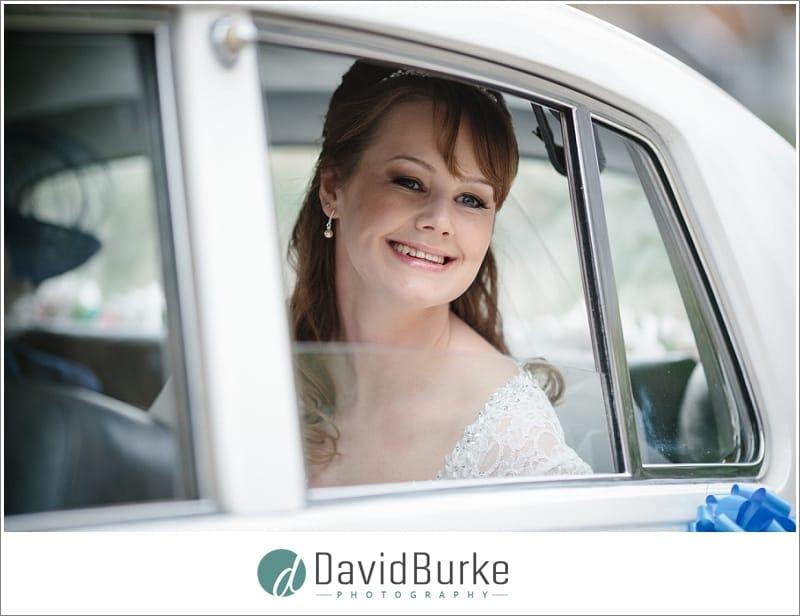 stunning bride in wedding car