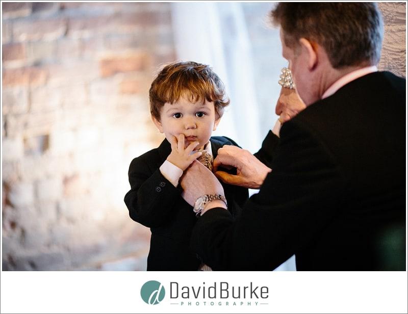 cute kid having his tie straightened