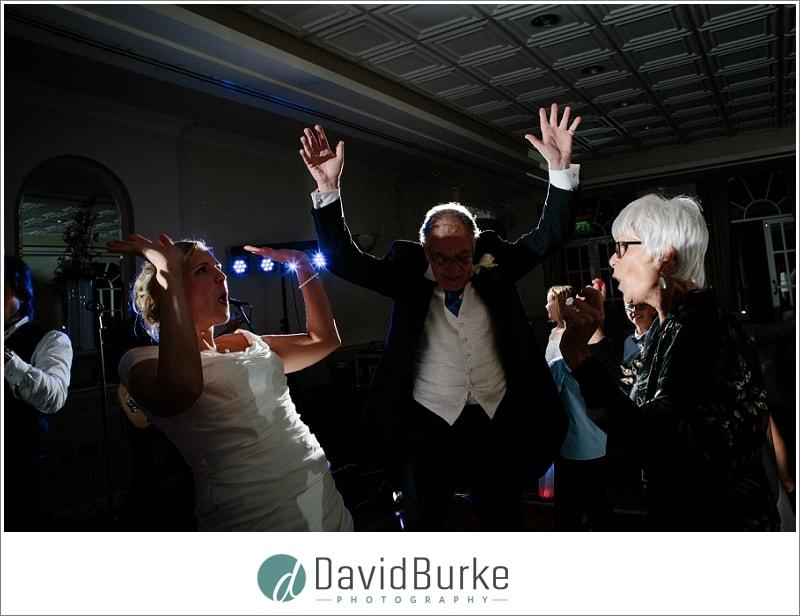 bride dancing with parents