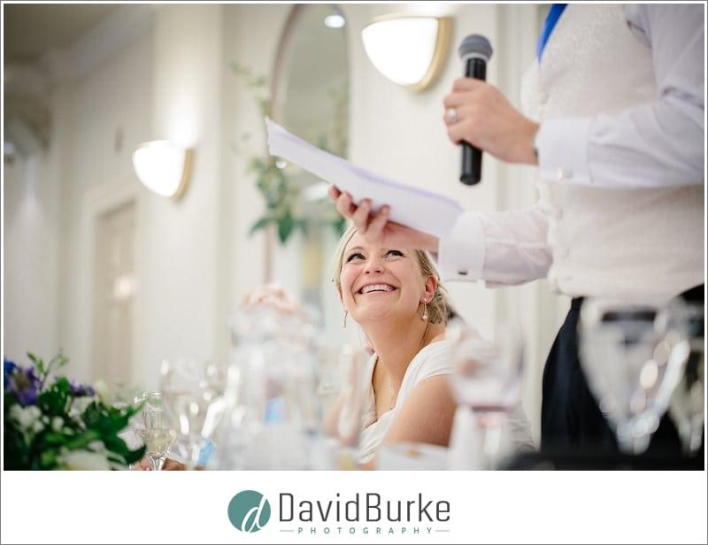 happy bride during grooms speech