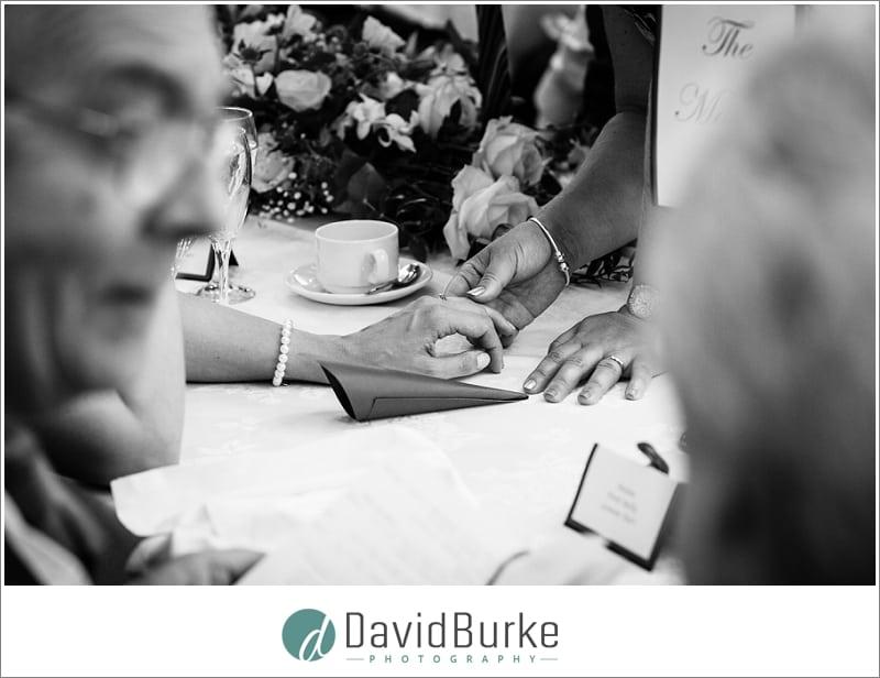 guest admiring brides wedding ring