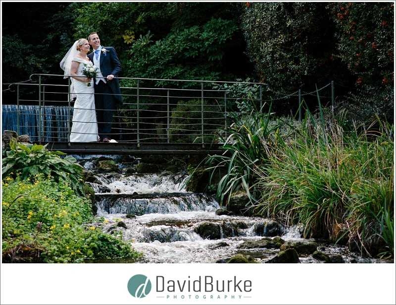 bride and groom on bridge at the orangery maidstone
