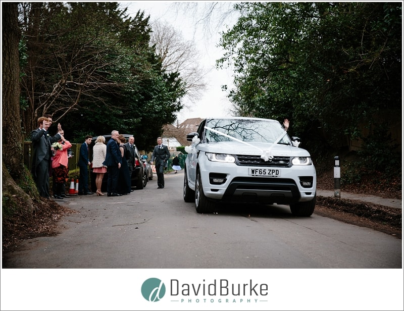 bride and groom leaving st thomas groombridge