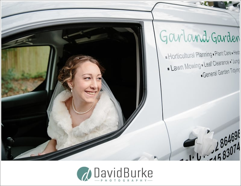 bride arriving in her dads work van