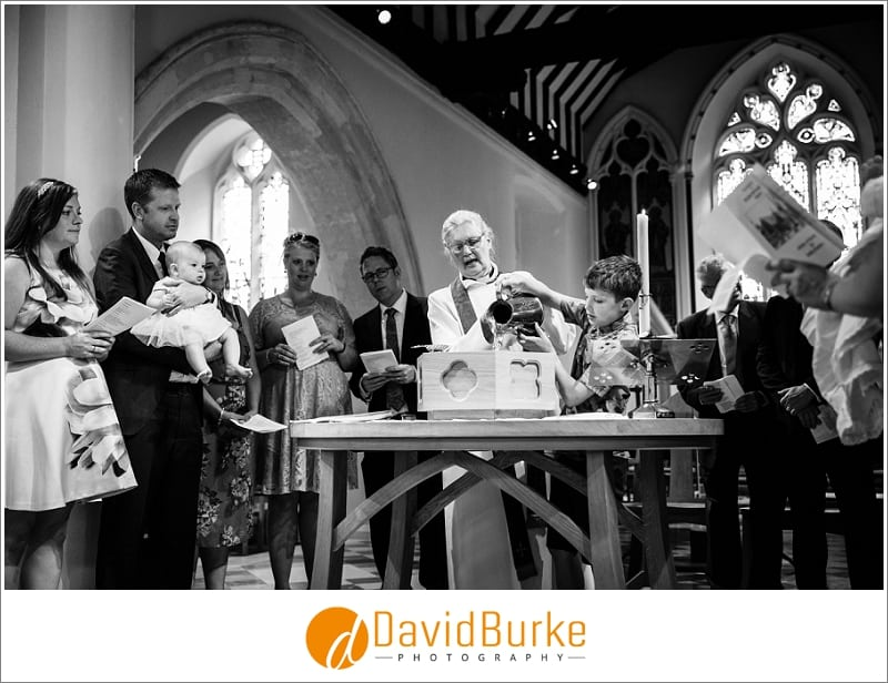 pouring holy water at christening