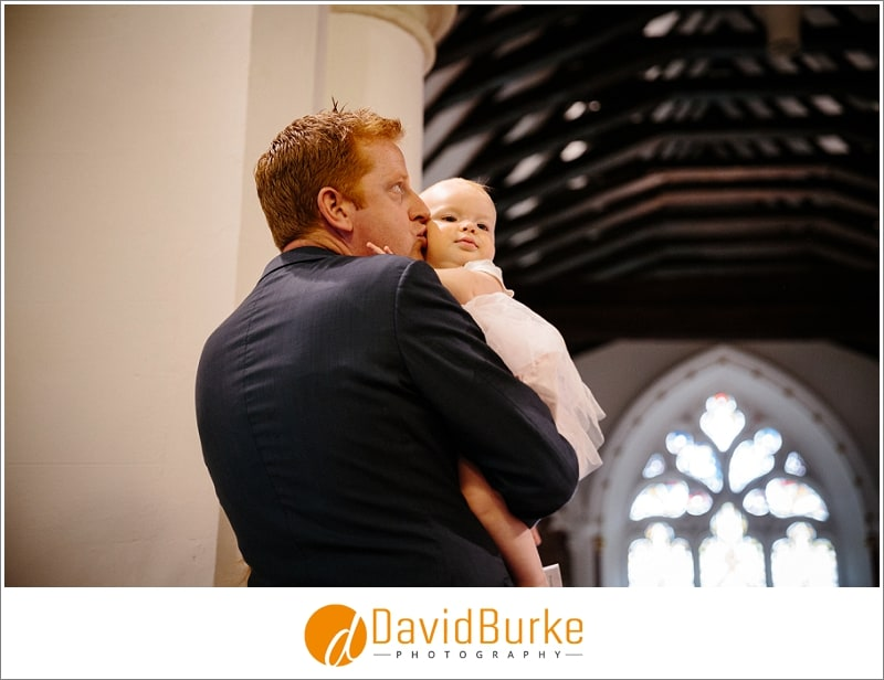 dad with baby at her christening