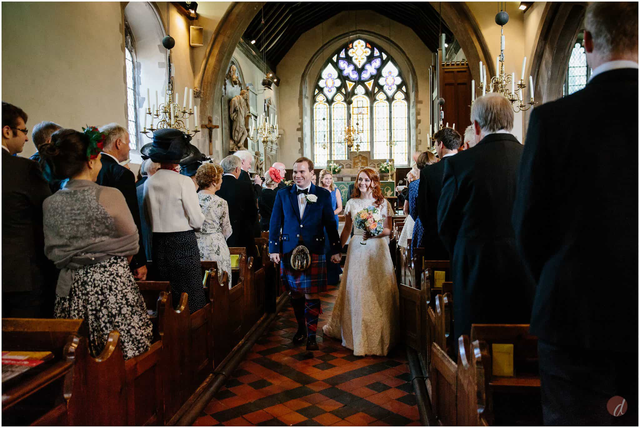 bride and groom exit st bartholemews otford