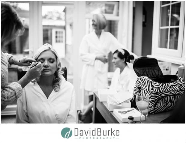 bride having makeup put on