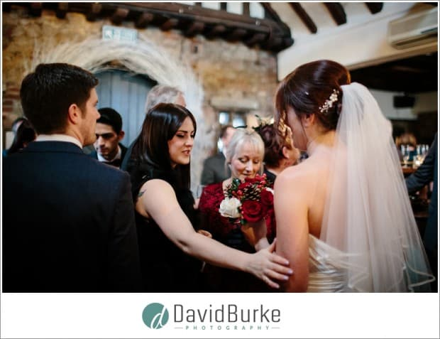 girl admiring brides dress