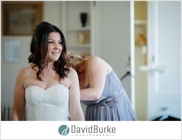 bride getting into dress chilston park