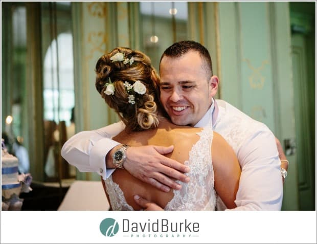 son hugging bride