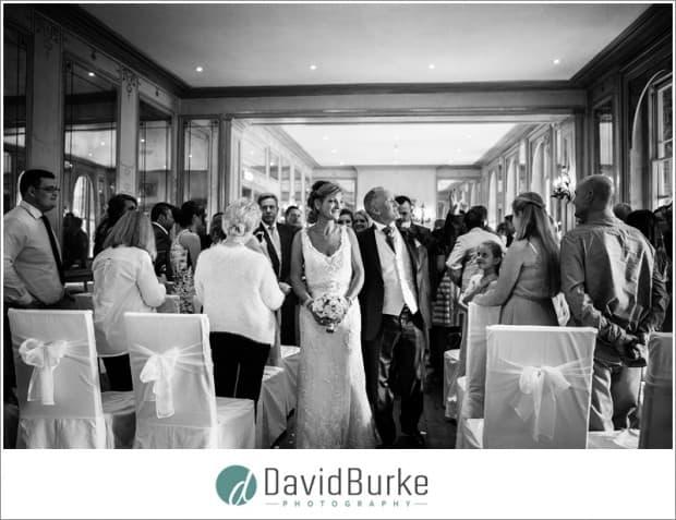 bride and groom exit ruinart room
