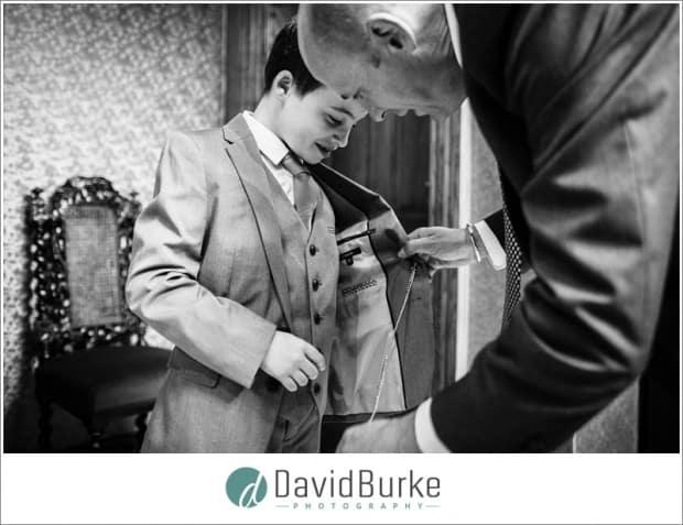 dad helps boy with pocket watch