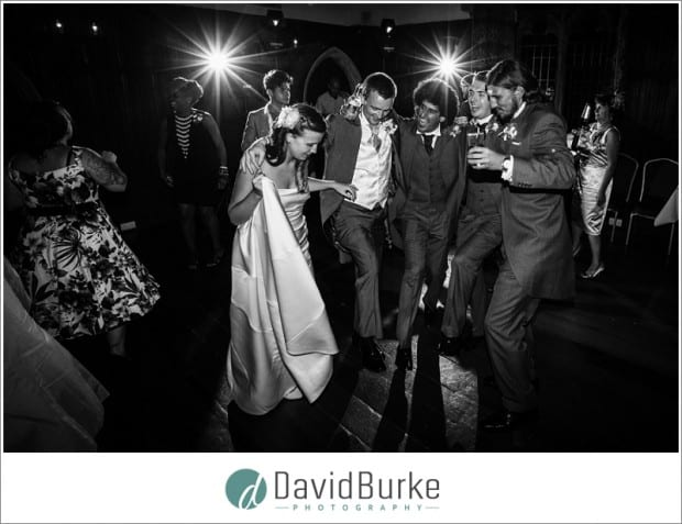 bride and groom dancing with friends