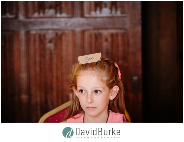 girl with placecard on her head