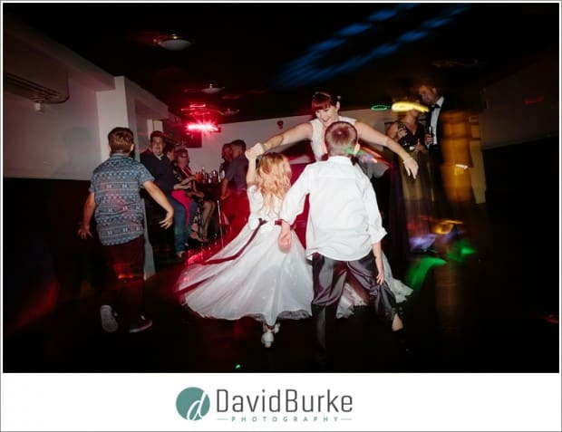 bride dancing with kids