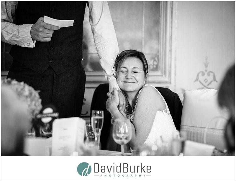 bride hugging grooms hand