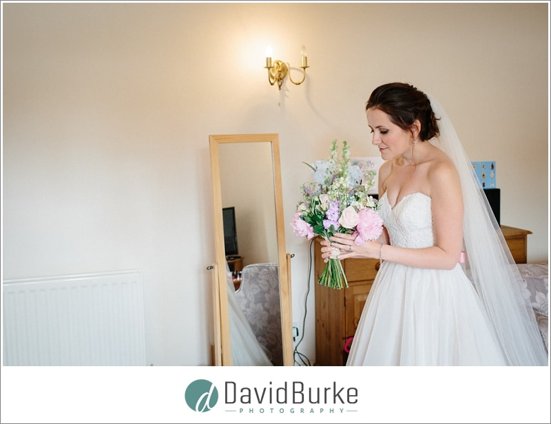 bride admiring bouquet