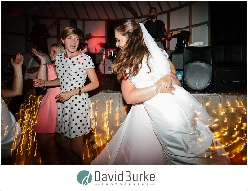 bride being picked up on dancefloor