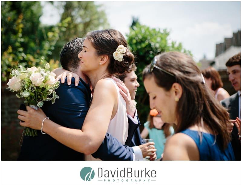 hug for groom from sister