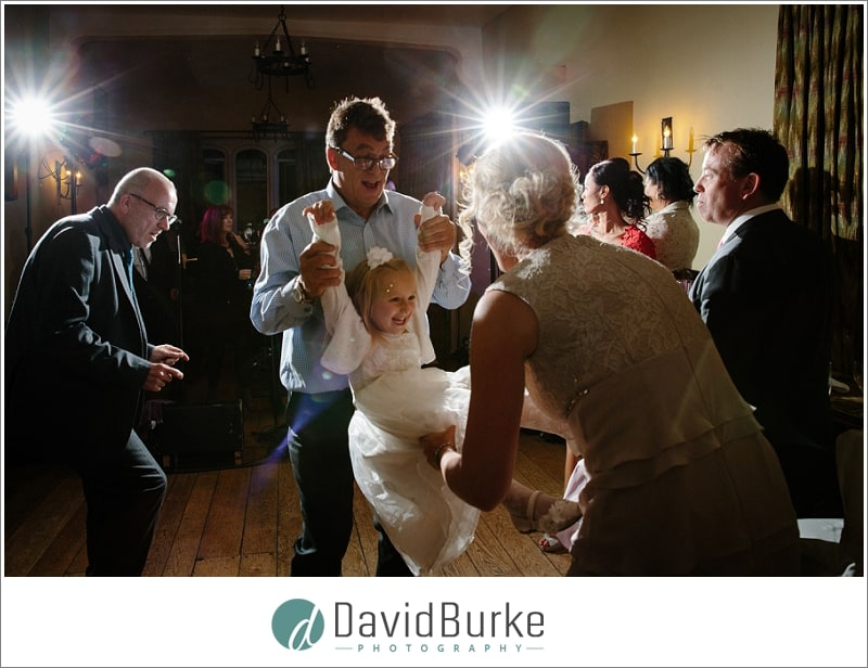 kid being swung at wedding