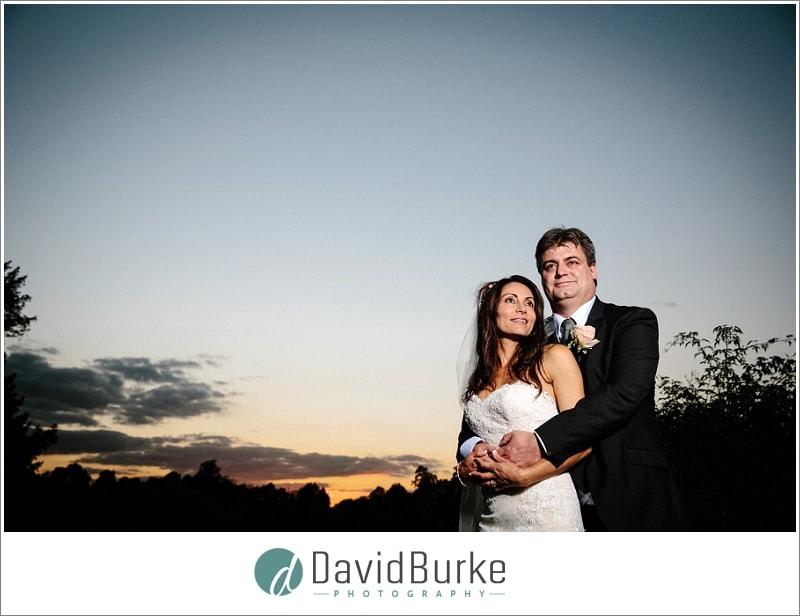 wedding couple at sunset leeds castle