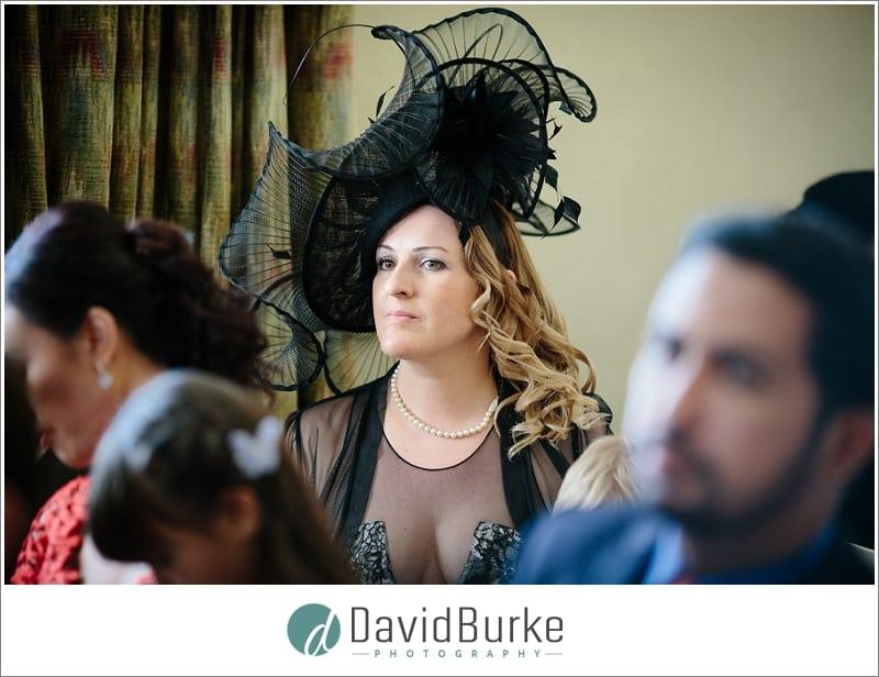 amazing hat on lady at wedding