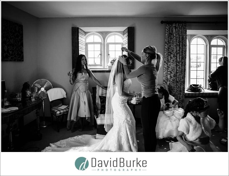 bride having veil put on