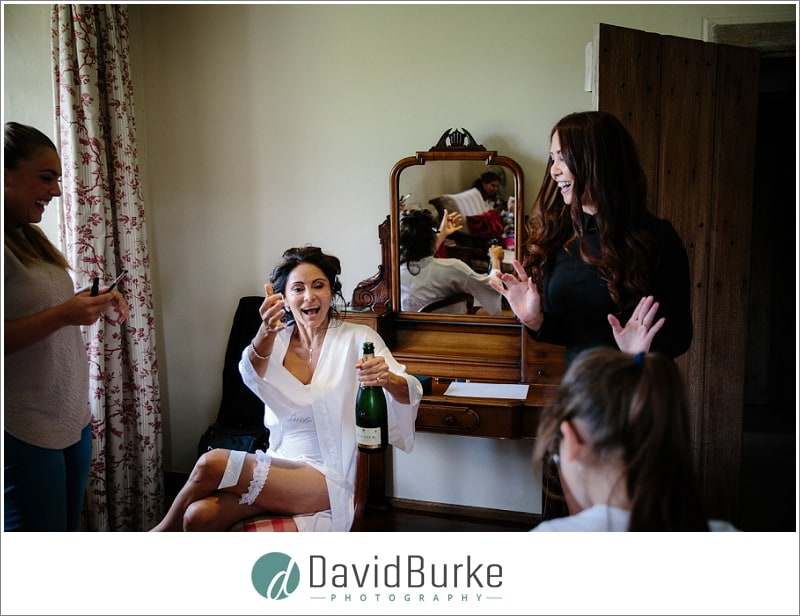 bride opening champagne